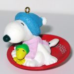 Snoopy and Woodstock on snow saucer sled Ornament